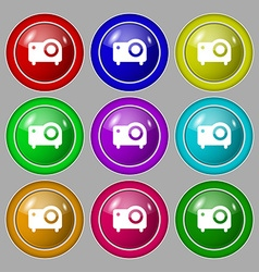Projector icon sign symbol on nine round colourful vector