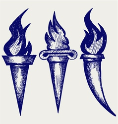 Set of flaming torches vector