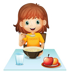 A little girl eating her breakfast vector