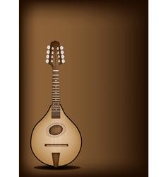 Antique mandolin on dark brown background vector
