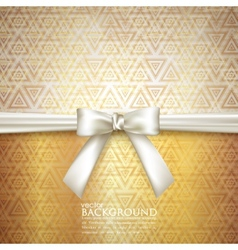 Golden background with white bow vector