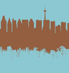 The city contour executed by a brush on a blue vector