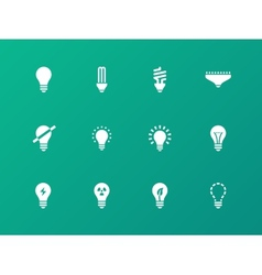 Light bulb and cfl lamp icons on green background vector