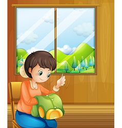 A lady sewing inside the house near the window vector