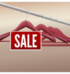 Wooden clothes hangers with sale label vector
