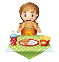 A child eating at a fastfood restaurant vector
