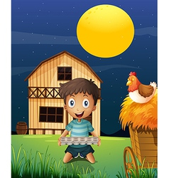 A boy collecting eggs in the evening vector