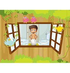 A boy with a towel inside the bathroom vector
