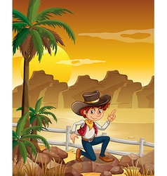 A young cowboy at the desert near the rocks vector