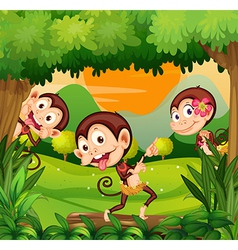 Three monkeys dancing in the forest vector