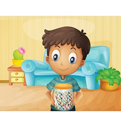A boy inside the house with a jar of candies vector