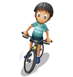 A boy biking wearing a helmet vector