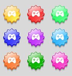 Joystick icon sign symbol on nine wavy colourful vector