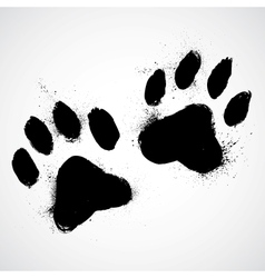Grunge dog paws vector