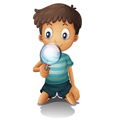 Boy and a magnifying glass vector
