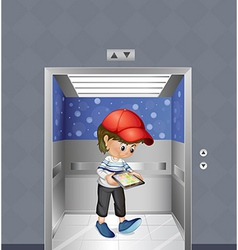 A boy with a tablet inside the elevator vector