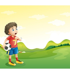 A tired young soccer player in his red uniform vector