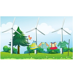 Hanging clothes in front of the windmills vector