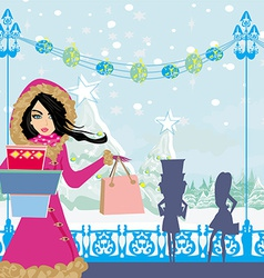 Beautiful girls on winter shopping vector