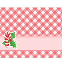 Checkered red background with candy canes and vector