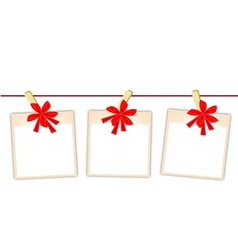 Blank photos with red ribbon vector