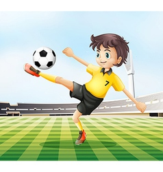 A football player kicking the ball vector