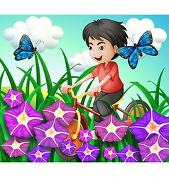 A boy biking in the garden with flowers and vector