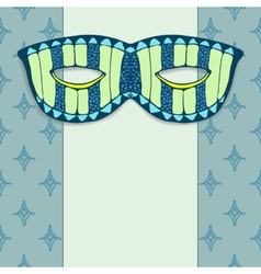 Masquerade mask on a blue background vector
