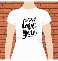 White shirt with love you text and winged heart vector
