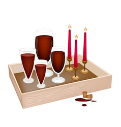 Candles with red wine in wooden container vector