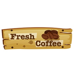 A wooden board with a fresh coffee label vector