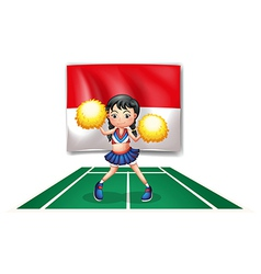 A cheerleader in front of the indonesian flag vector