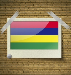 Flags mauritius at frame on a brick background vector
