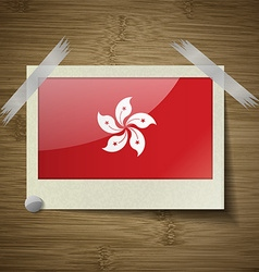 Flags hong kong at frame on wooden texture vector