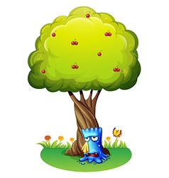 A blue monster sobbing under the tree vector