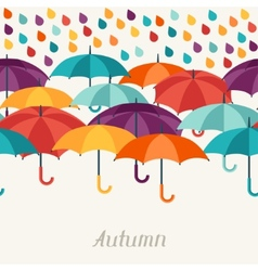 Autumn background with umbrellas in flat design vector