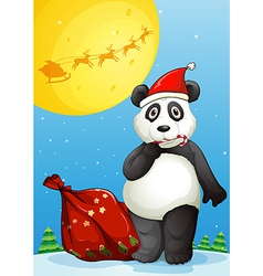 A panda wearing santas hat while eating a cane vector