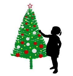 Girl putting decoration on christmas tree vector