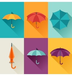 Set of cute multicolor umbrellas in flat design vector