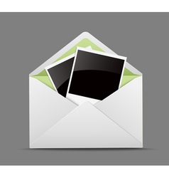 Open envelope with photo frames vector