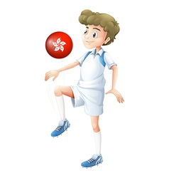 A boy using the ball with the flag of hongkong vector