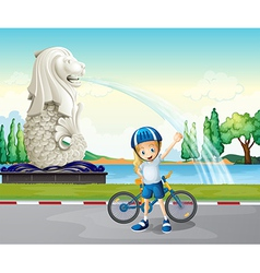 A young biker near the statue of merlion vector