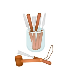 Set of carving tools in a jar vector