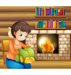 A woman sewing near the fireplace vector