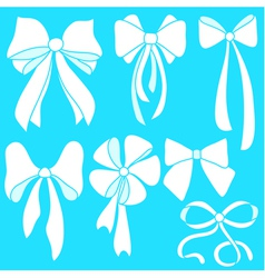 Set of white bows on blue background vector