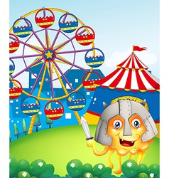 A hill with a carnival and a brave monster vector