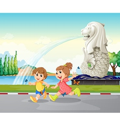 Two kids playing near the statue of merlion vector