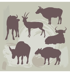 Cow bull and deer silhouette on grunge background vector