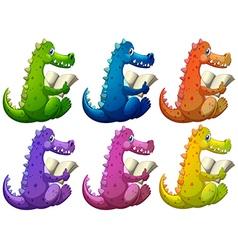 Colorful crocodiles reading vector