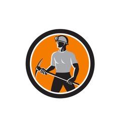 Coal miner holding pick axe side circle retro vector